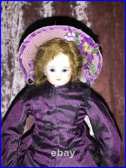 11 Antique French Fashion Doll. Solid Dome Head