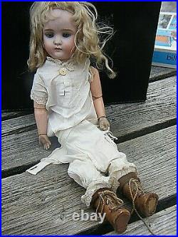 Antique German Bisque Head Doll With Wooden Limbs