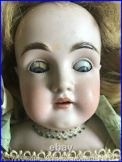 Antique bisque Head doll 25 sleep eyes, marked 10 DY Germany