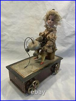 German Victorian bisque head doll mechanical Pull toy