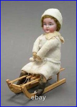 Original antique German Christmas Candy Container girl sledder